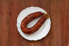 Smoked sausage on plate Royalty Free Stock Images