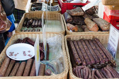 Smoked sausage put in basket sold at market Stock Image
