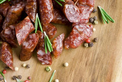Smoked sausage. With rosemary and peppercorns Stock Photo