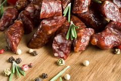 Smoked sausage with rosemary and peppercorns.  Stock Photos