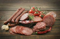 Smoked sausage with rosemary and peppercorns.  Royalty Free Stock Photo