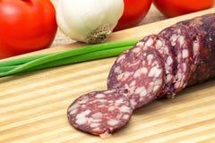 Smoked sausage and rustic food Stock Photo