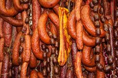Smoked sausage, Salami. Dry sausage with herbs Royalty Free Stock Images