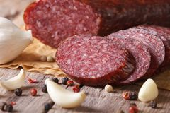 Smoked sausage with spices and garlic on old table. Horizontal Stock Photos