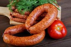 Smoked sausage on a  table Royalty Free Stock Image