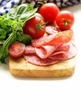Smoked sausage, tomatoes and basil Royalty Free Stock Photo