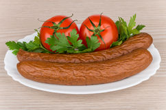 Smoked sausage, tomatoes and parley in glass dish Royalty Free Stock Image