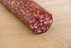 Smoked sausage on wooden background close up royalty free stock photo