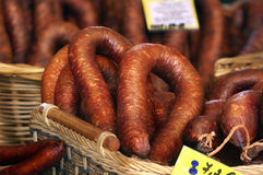 Smoked sausages in baskets with price tags Royalty Free Stock Photography