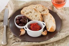 Smoked sausages in bowl with olives Royalty Free Stock Photography