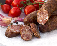 Smoked sausages with greens, cherry tomatoes. Smoked sausages with cherry tomatoes and salad Royalty Free Stock Photography