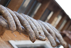 Smoked sausages hanging to dry Royalty Free Stock Photography