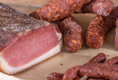 Smoked sausages and loin bacon Stock Image