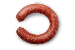 Smoked sausages. One sausage is cut. Isolated on a white background royalty free stock images