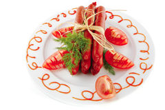 Smoked sausages on a plate Stock Photo