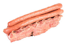 Smoked sausages and pork ribs. On white background Stock Photography