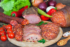 Smoked sausages, salami and ham Royalty Free Stock Photography