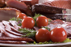 Smoked sausages (sausage) and vegetables. Royalty Free Stock Photos