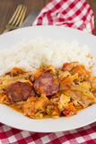 Smoked sausages with vegetables and boiled rice Royalty Free Stock Photography