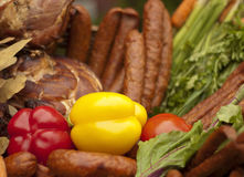 Smoked sausages with vegetables Stock Photos