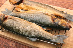 Smoked sea bass. On a wooden table background stock image