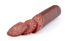 Smoked sliced salami. Isolated on white stock photography