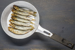 Smoked sprats. In the pan Stock Photography