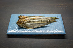 Smoked sprats. On a table Royalty Free Stock Photos