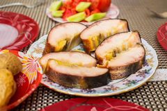 Smoked sturgeon fillets on a plate Stock Image