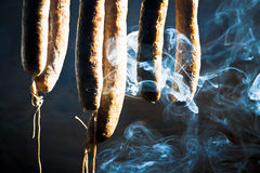 Smoked and suspended sausage. In forester's lodge Royalty Free Stock Photography