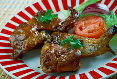 Smoked Texan chicken wings. Great for lunch, a barbecue or picnic Royalty Free Stock Photo