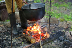 Smoked tourist kettle on hot fire Stock Images