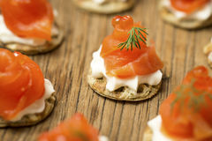 Smoked Trout amuse bouche on a wooden table Stock Photo