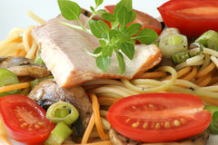 Smoked trout with colored spaghetti and vegetable Stock Photo