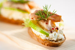 Smoked trout on green apple and cream cheese Royalty Free Stock Photography