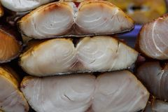 Smoked tuna fish steaks, prepared seafood close up stock images