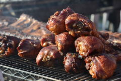 Smoked Turkey Legs. Several smoked turkey legs on the grill Stock Image