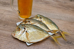 Smoked Vomer and glass of lager beer on a wooden table Royalty Free Stock Photos
