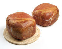 Smoked whole ham on cutting board Royalty Free Stock Photos