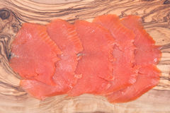 Smoked wild pacific sockeye salmon. On olive wood cutting board Royalty Free Stock Photos