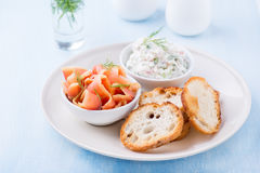 Smoked wild salmon, baguette and soft cheese spread with herbs. Selective focus Stock Image