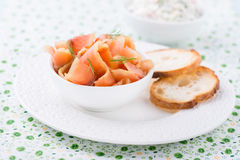 Smoked wild salmon and baguette on white plate Royalty Free Stock Images
