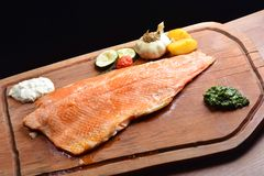 Smoked wild salmon fillet with vegetable Stock Image
