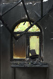 Smoked window. The wall with a window after fire Royalty Free Stock Photo