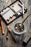 Smoked a wooden pipe with cigarettes Stock Photography