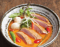 Smoked Yi-Liang Duck in red curry with Lichee Royalty Free Stock Image