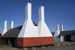 Smokehouse Chimnies. Bornholm, Denmark. The little village, Hasle, a few kilometer north of the main city on Bornholm, Rornne, is famous for its old herring stock images