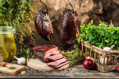 Smokehouse ham preparation for smoking in countryside Stock Images