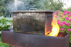Smokehouse. A metal box with the meat on the firen Royalty Free Stock Image
