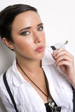 Female Smoker Poses Cigarette Burning Looks to You Royalty Free Stock Photography